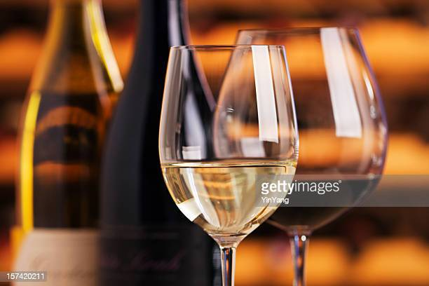 Red and White Wine in Glasses with Bottles, Cellar Background