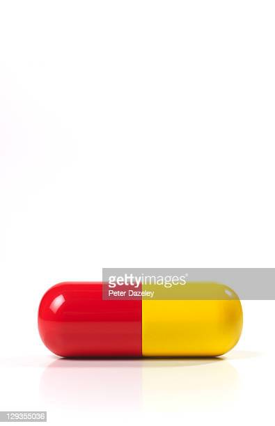Red and yellow capsule with copy space