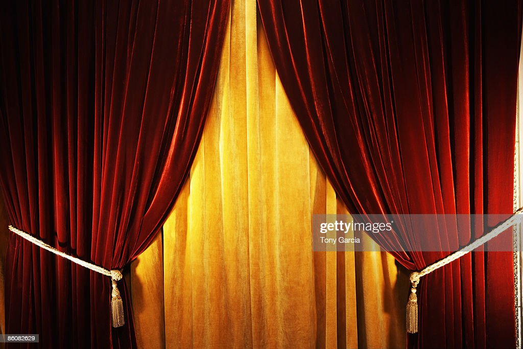 red and yellow curtains stock photo getty images. Black Bedroom Furniture Sets. Home Design Ideas