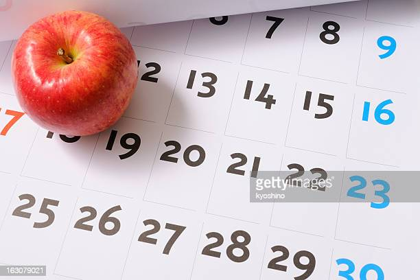 Red apple on calendar