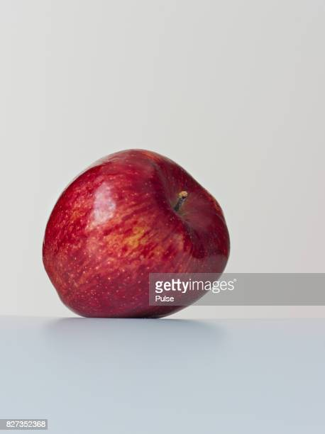 Red apple on light background