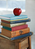 Red apple on pile of school books