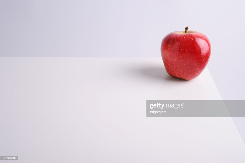 Red apple on white table : Stock Photo