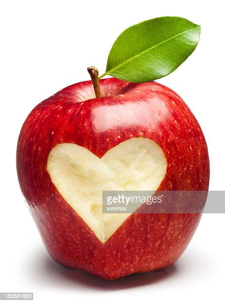 A red apple with a heart inside of it