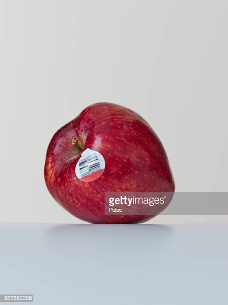 Red apple with label on light background