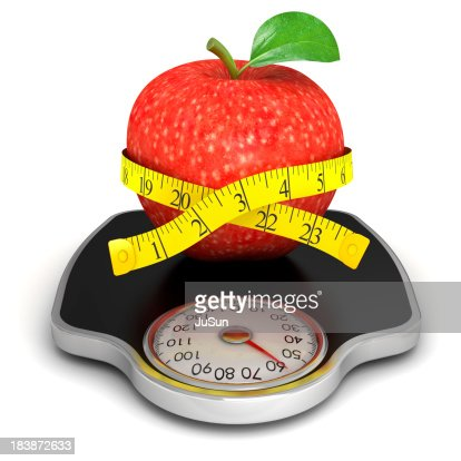 Red apple with measuring tape on the scales