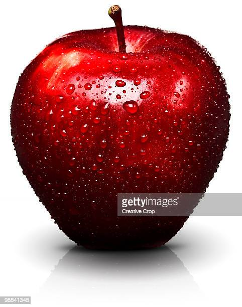 Red apple with water droplets