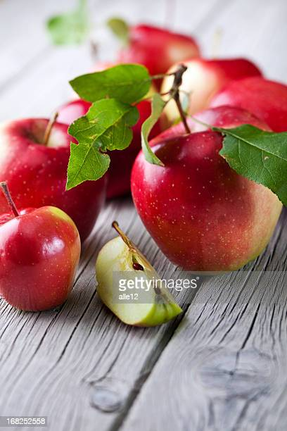Red apples cut up with stems and leaves