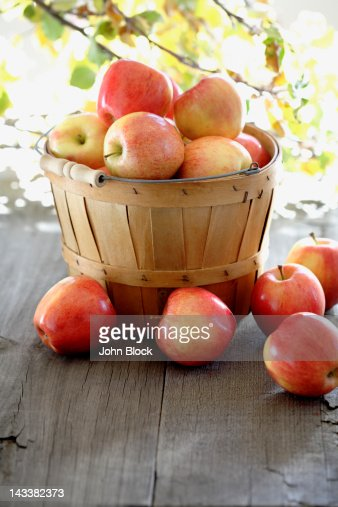 Red apples overflowing basked : Stock Photo