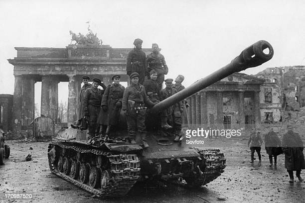 Red army soldiers aboard a joseph stalin tank at the brandenburg gates in berlin germany at the end of world war 2 may 1945
