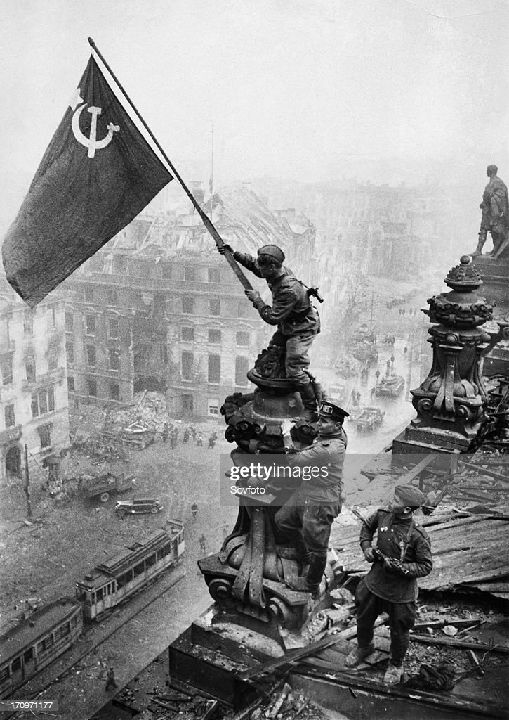 Red army soldiers raising the soviet flag over the reichstag in berlin germany april 30 photo taken by vladimir grebnev