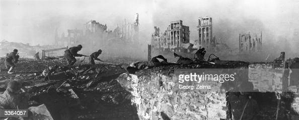 Red Army troops storming an apartment block amidst the ruins of wartorn Stalingrad during World War II This is a composite image