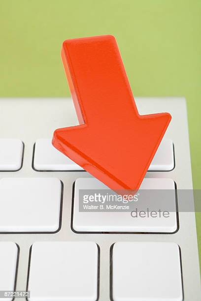 Red arrow pointing to delete key on keyboard