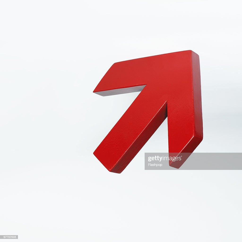 Red arrow pointing upwards : Stock Photo