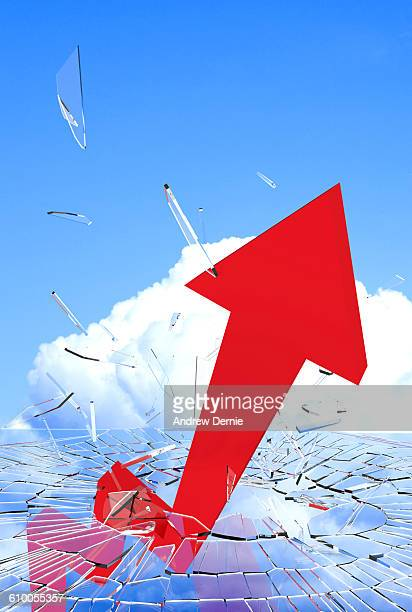 Red arrow symbol breaking through a sheet of glass