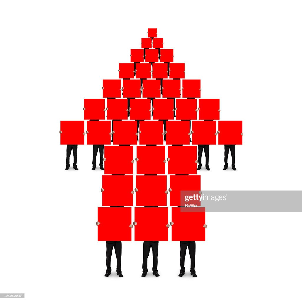 Red arrow up shape composed of boards holding by men : Stock Photo