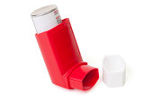 Red asthma inhaler with cap off