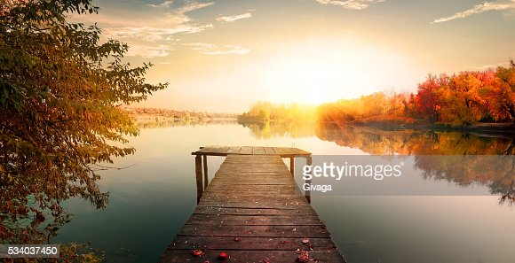 Red autumn and fishing pier : Stock Photo
