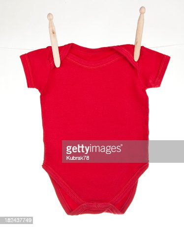 Red baby bodysuit hanging on a clothesline