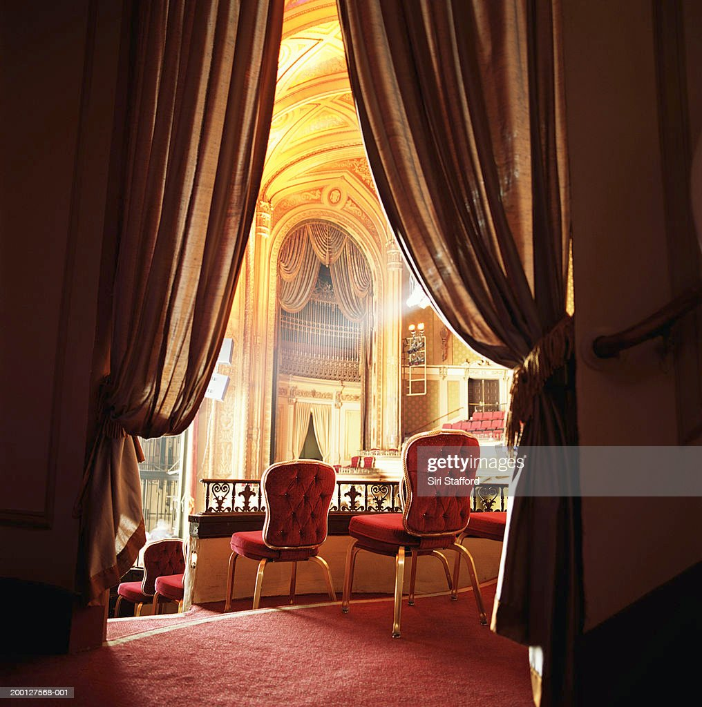 Red balcony seats in theater, rear view : Stock Photo