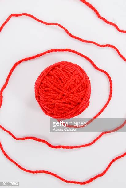 A red ball of yarn.