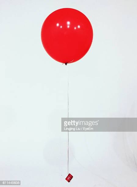 Red Balloon Against White Background