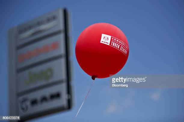 A red balloon is seen at a Fiat Chrysler Automobiles car dealership in Moline Illinois US on Saturday July 1 2017 Ward's Automotive Group released US...