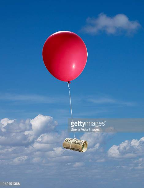 red balloon with dollar bills