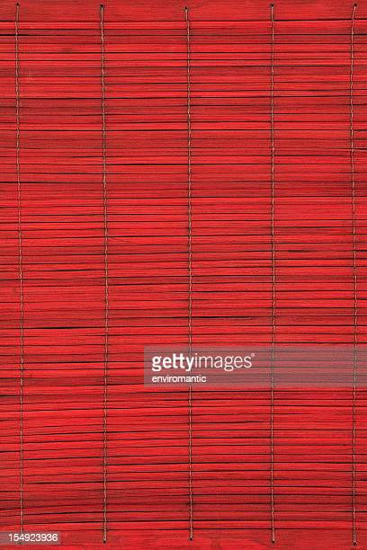 Red bamboo slatted background.