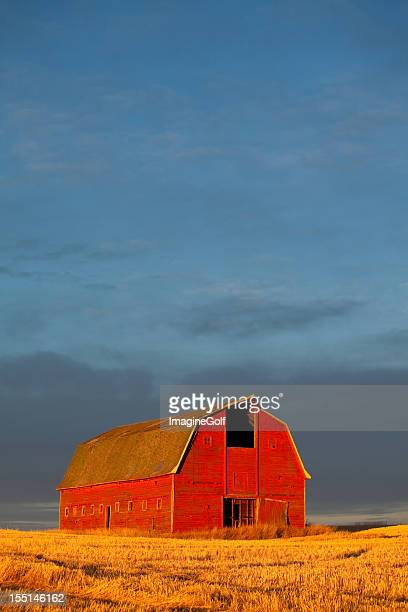 Red barn against a setting sun