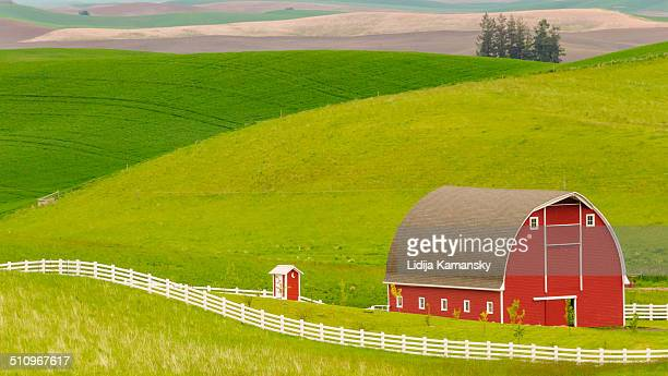 Red barn and rolling hills