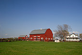 Farm with red barn and white house, grass field, and a sky with a nice blue gradient in mid afternoon. This is in Virginia, USA. Also see the winter version of this shot;