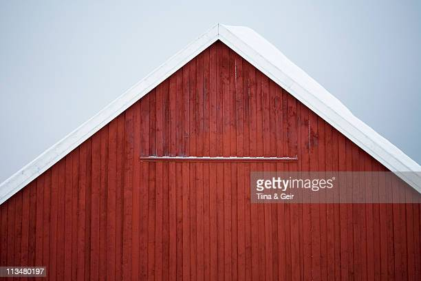 Red barn covered with snow