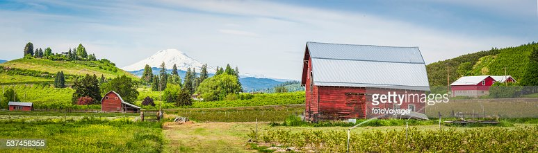 Red barn green farm agricultural landscape white mountain peak panorama