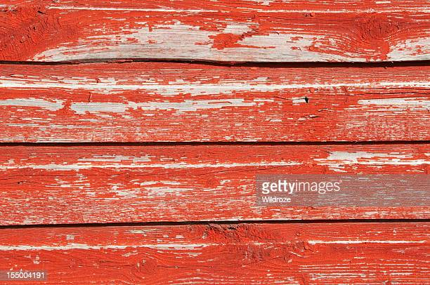 Red barn wood planks with peeling paint