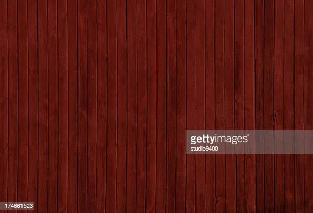 Binario di legno rosso di un fienile