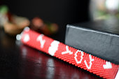 Red beaded I Love You bracelet on a dark background close up