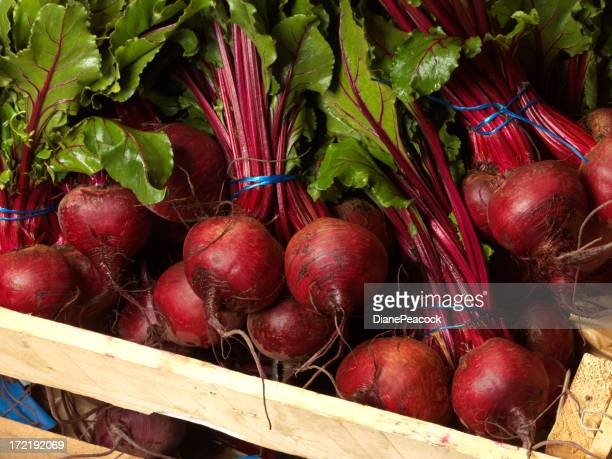 Red beet roots bundled in a wood crate