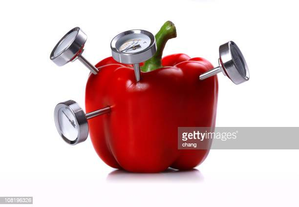 Red Bell Pepper with Meat Thermometer's Stuck In It