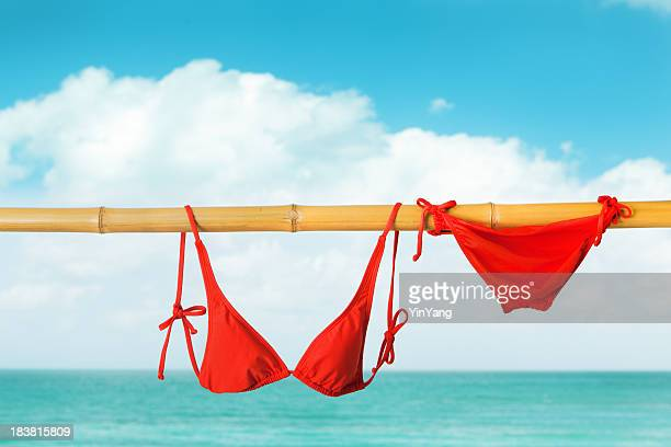 Red Bikini Swimwear Clothing Hanging on Bamboo Pole in Cancun