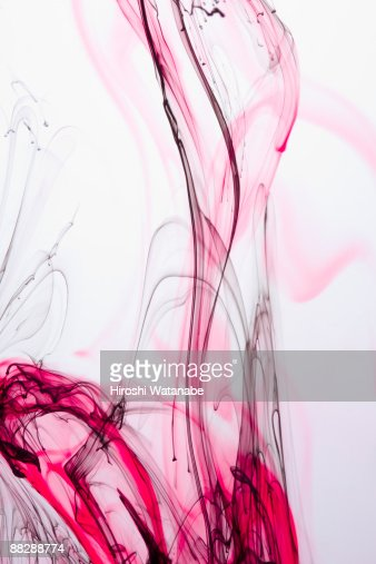 Red & black ink spreading in water : Stock Photo