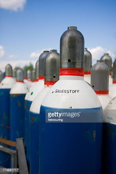 Red, blue and white oxygene gas bottles