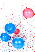 Red Blue Balloons and Confetti Falling Against White