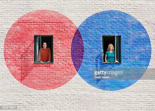 Red & blue circles around windows (2 people)
