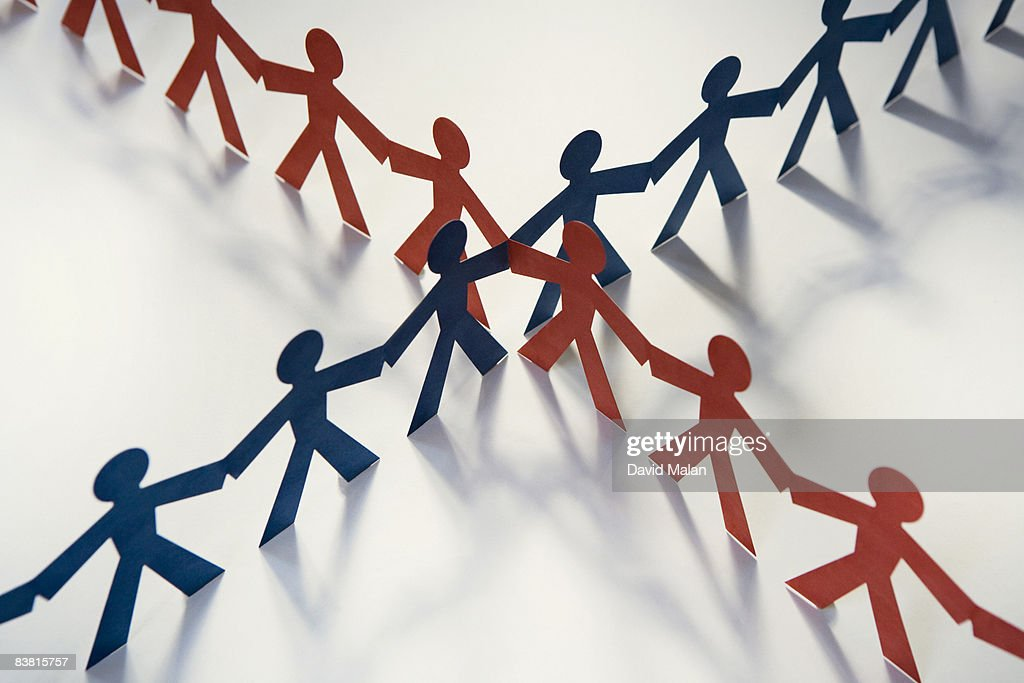Red & blue cut out figures crossing : Stock Photo