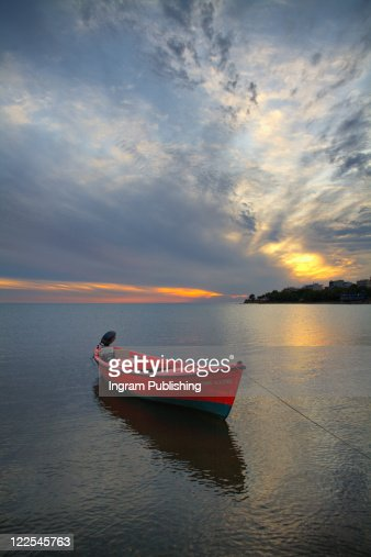 Red Boat At Sunset : Stock Photo