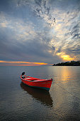 Red Boat At Sunset