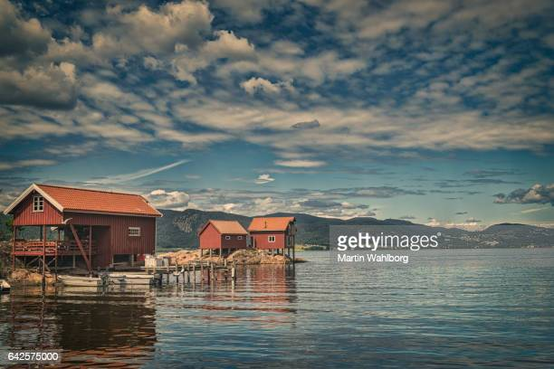 Red boathouses in Norway