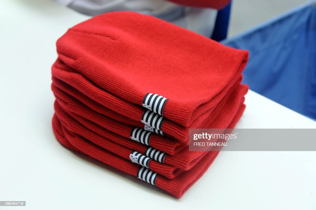 Red bonnets are pictured on October 31, 2013 at the textile factory Armor Lux in Quimper, western France. These red bonnets became a symbol of anger in Brittany's social crisis. AFP PHOTO / FRED TANNEAU