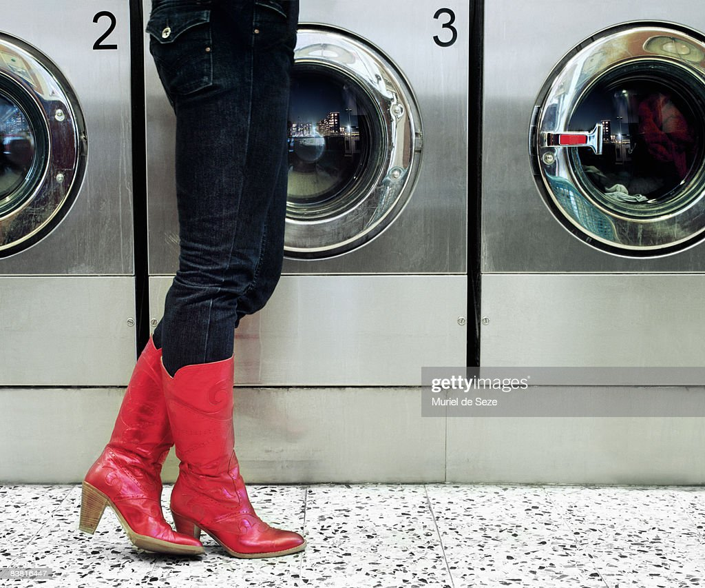 red boots at laundromat : Stock Photo